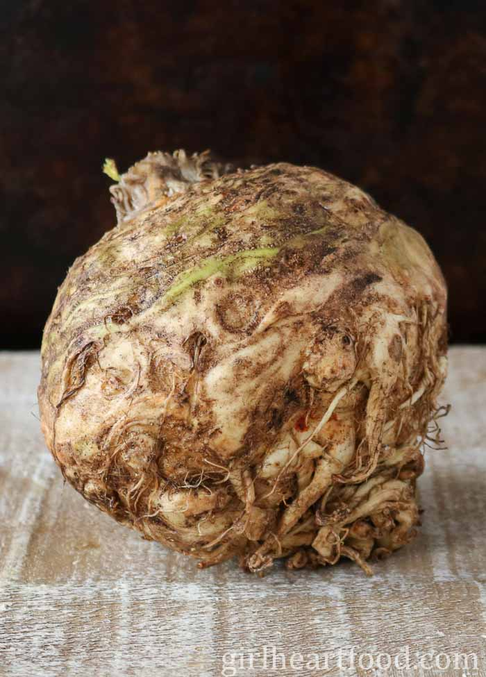 Unpeeled and uncooked bulb of celeriac.
