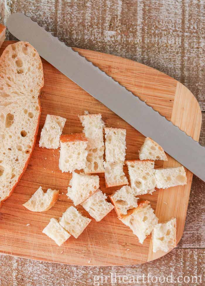 Bread being cut into cubes for bread croutons.