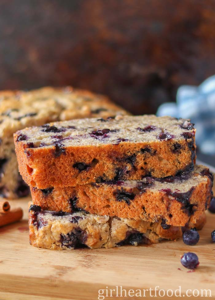 Stack of three slices of blueberry banana bread.