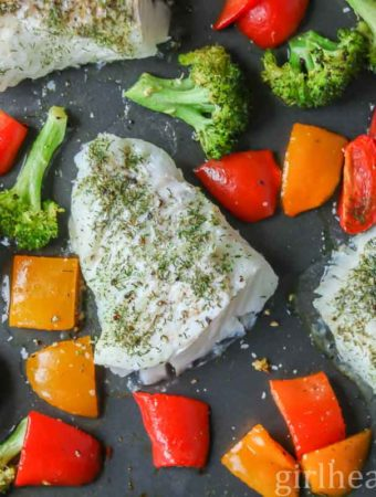 Oven baked cod fillets on a sheet pan with bell pepper and broccoli.