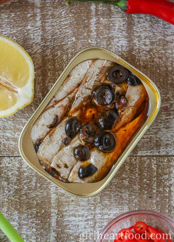 Tinned sardines in oil with olives.