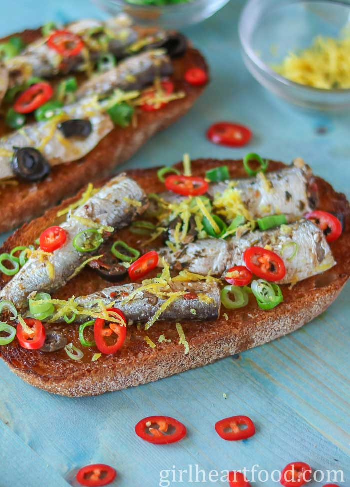 Tinned sardines on toast with chili, lemon and green onion.