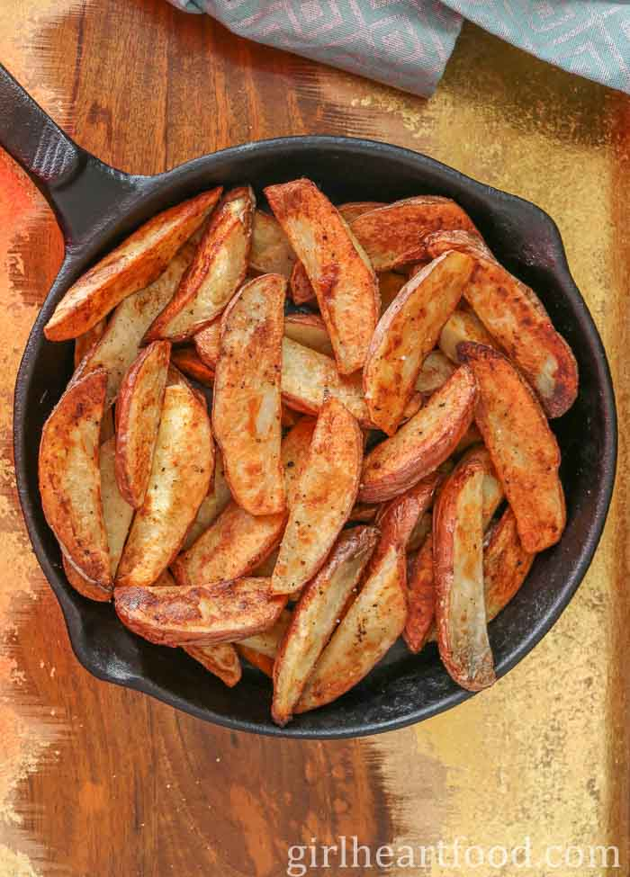 Crispy wedges in a cast-iron skillet.