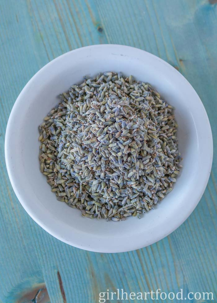Dried lavender in a small round white dish.