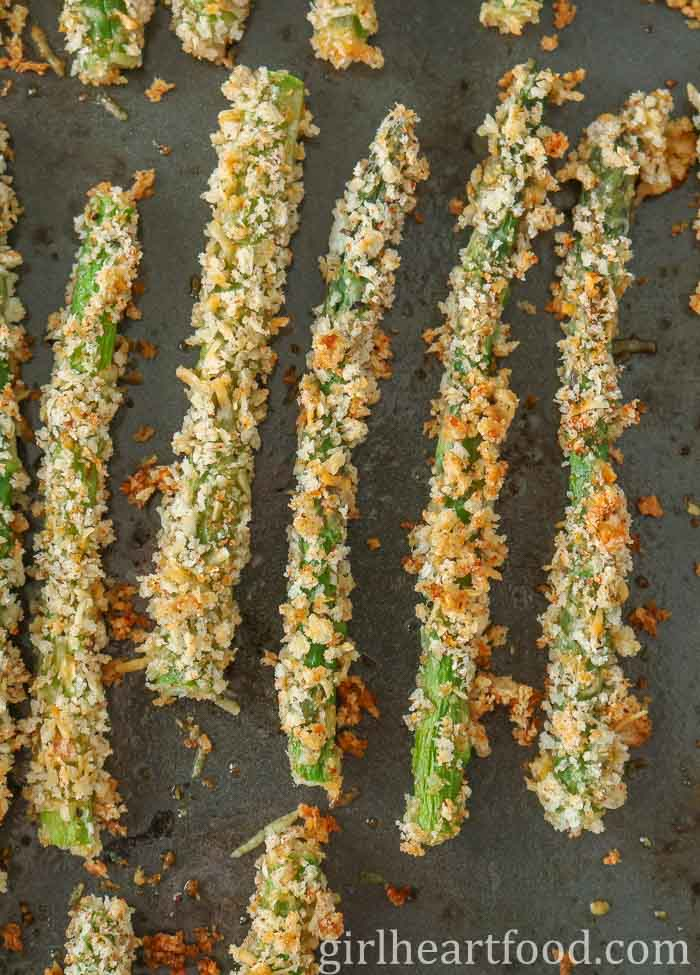 Panko parmesan asparagus on a sheet pan.
