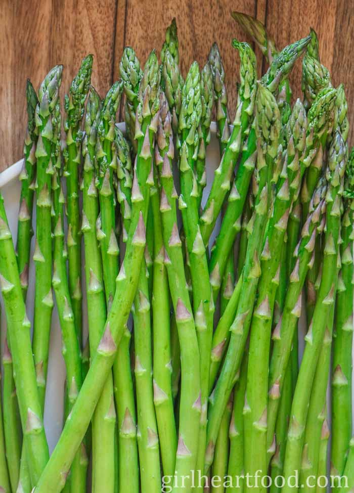 Raw asparagus on a plate.