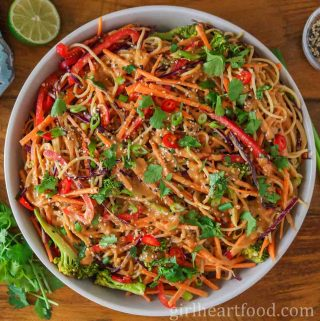 Dish of peanut noodles and vegetables.