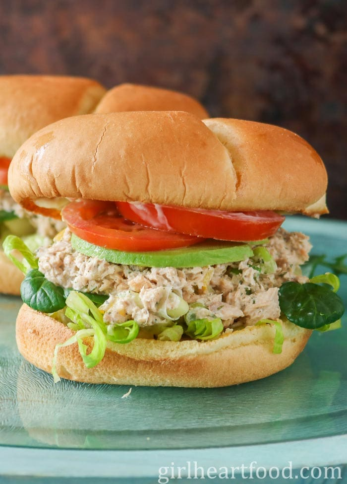 Garnish canned salmon sandwich with another sandwich behind it.