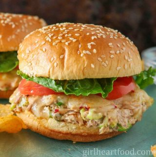 Tuna melt sandwich with tomato and lettuce.