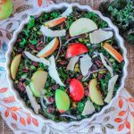 Raw kale and apple salad with shavings of parmesan over top.