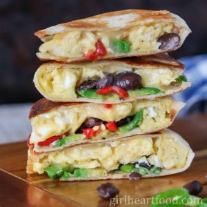 Stack of four scrambled egg breakfast quesadillas.