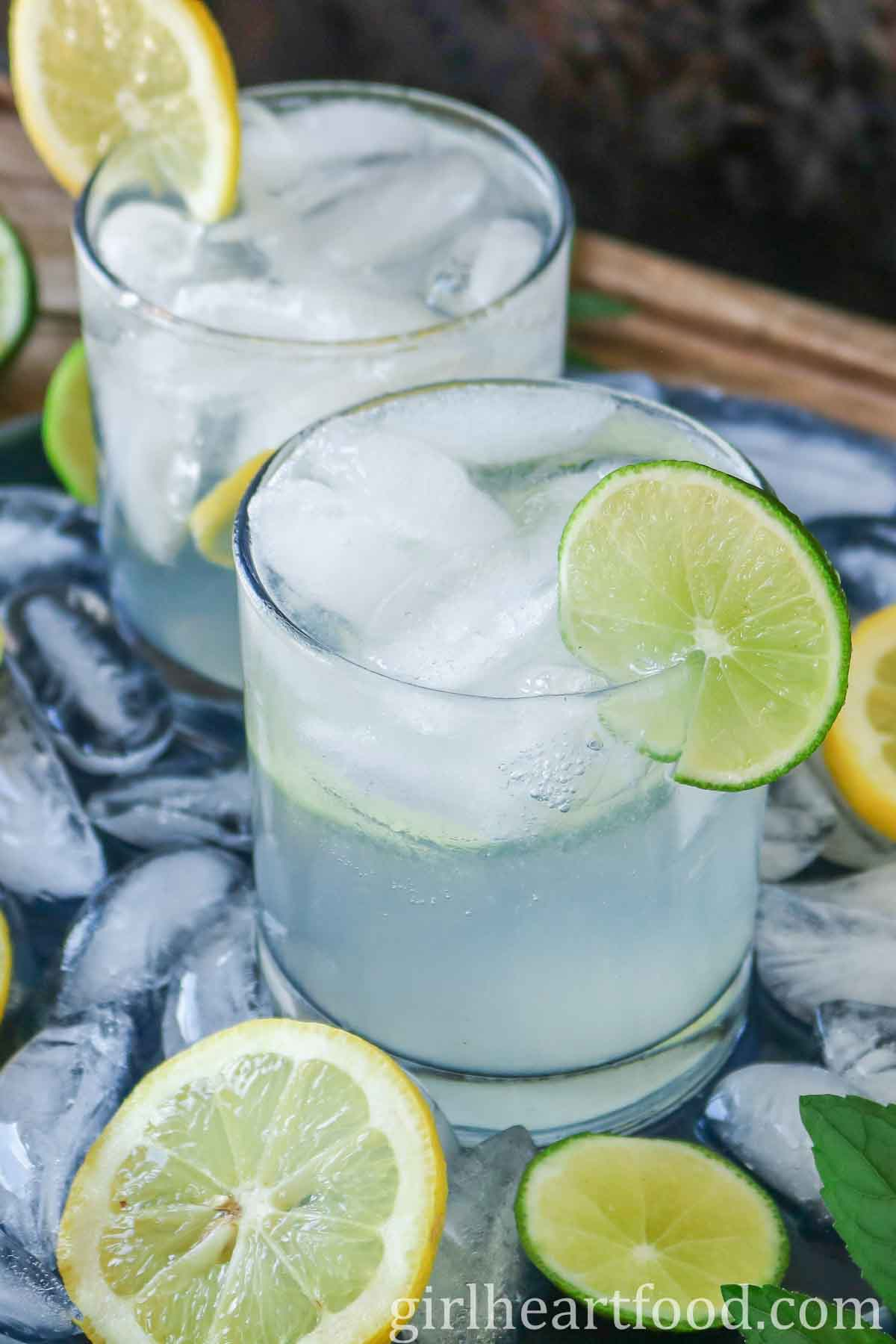 Vodka soda garnished with a lime slice.
