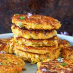 Close up of a stack of butternut squash fritters.