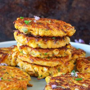 Tall stack of butternut squash fritters.