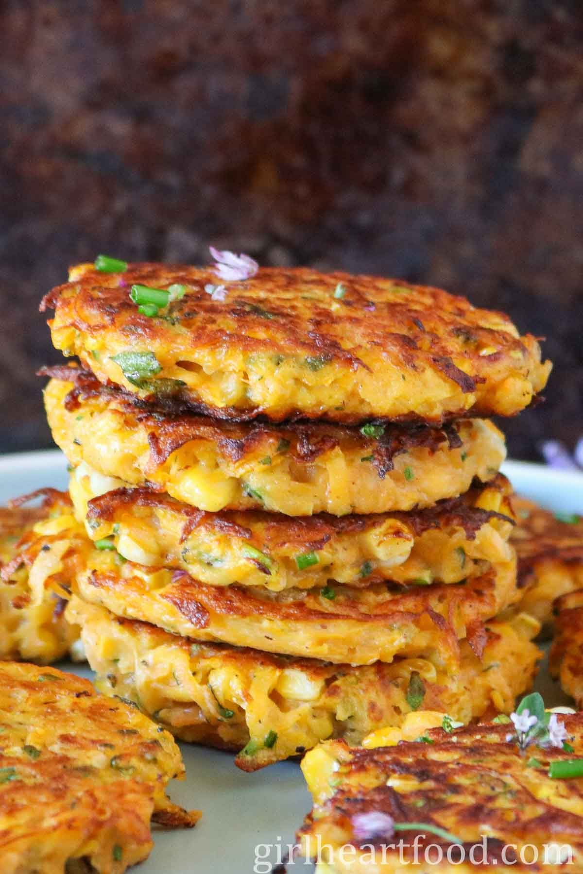 Close-up of a tall stack of butternut squash fritters.