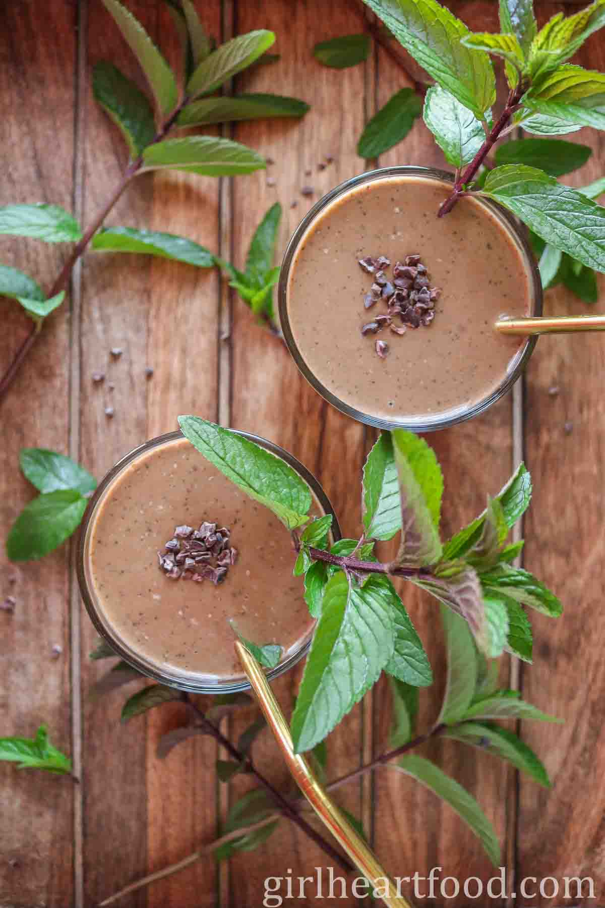 Overhead shot of two glasses of chocolate mint smoothie.