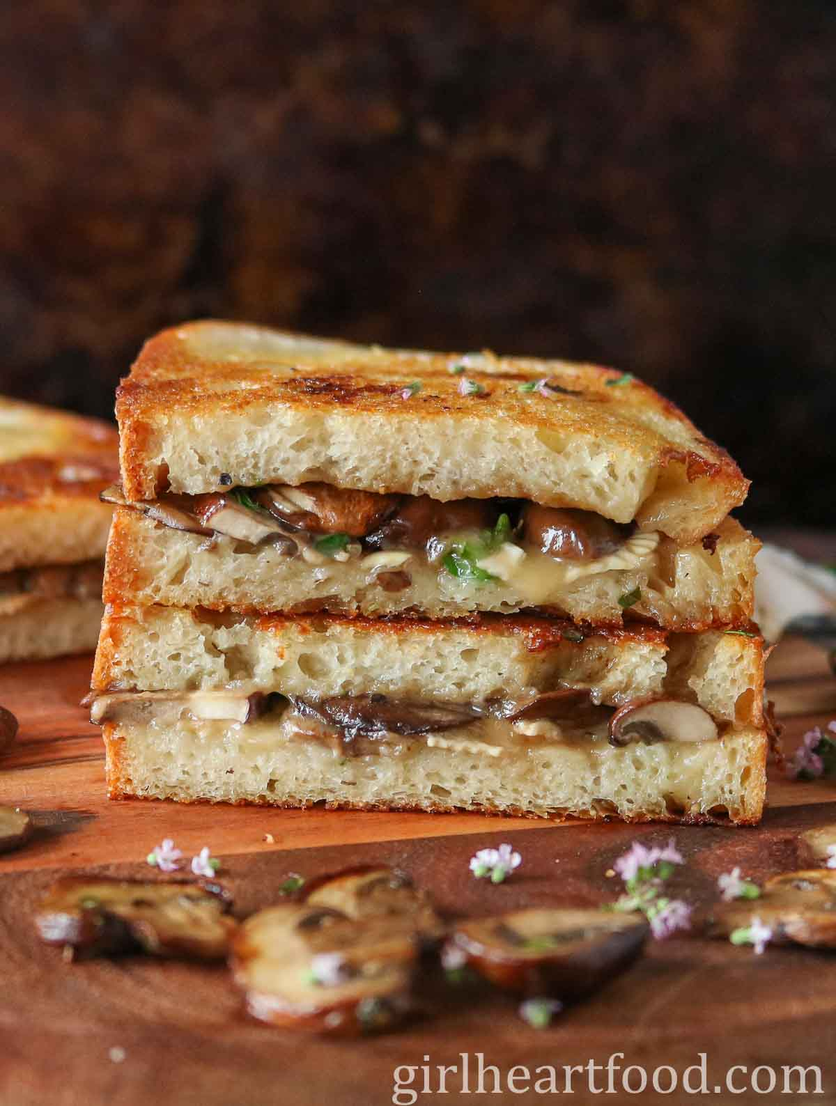Stack of two halves of a mushroom Brie sandwich.