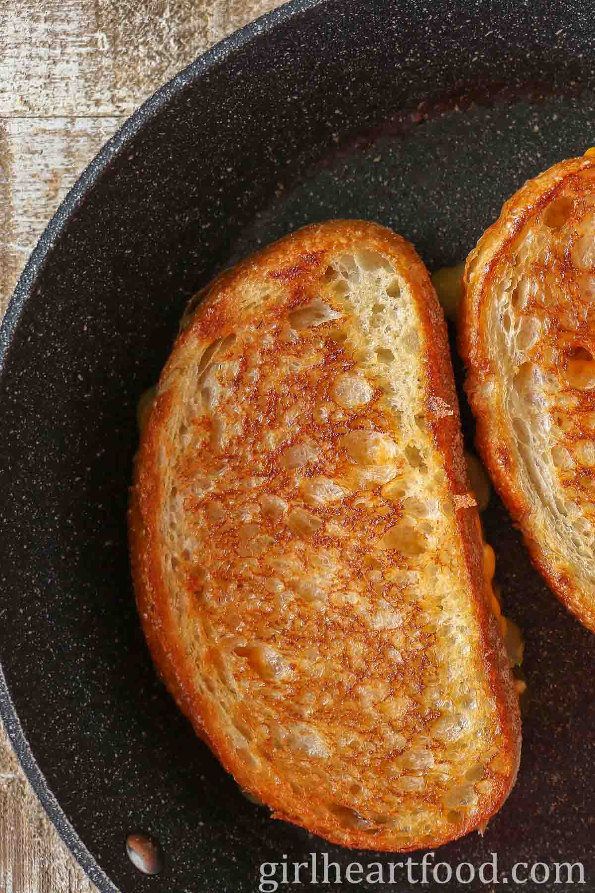 Grilled cheese sandwich in a non stick pan.