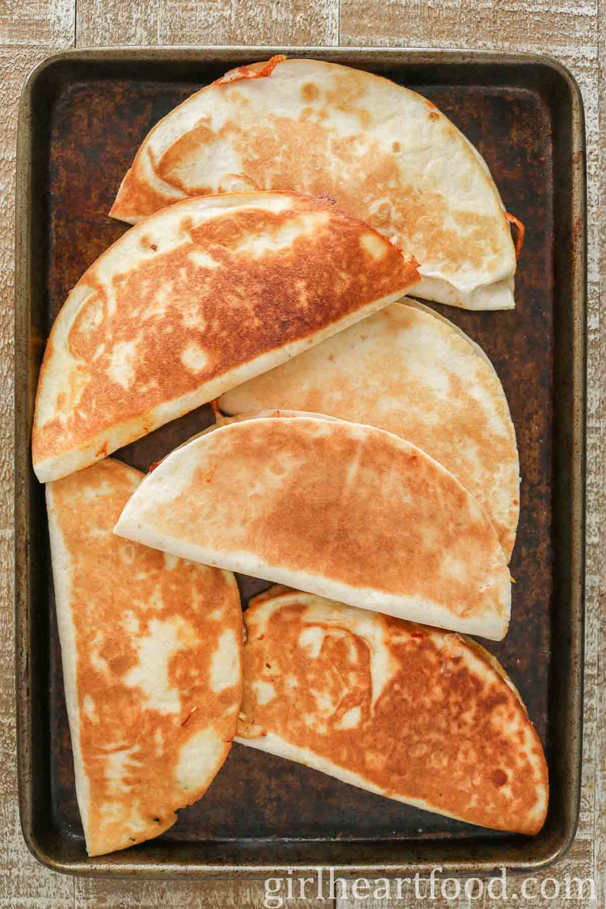 Crispy quesadillas on a sheet pan.