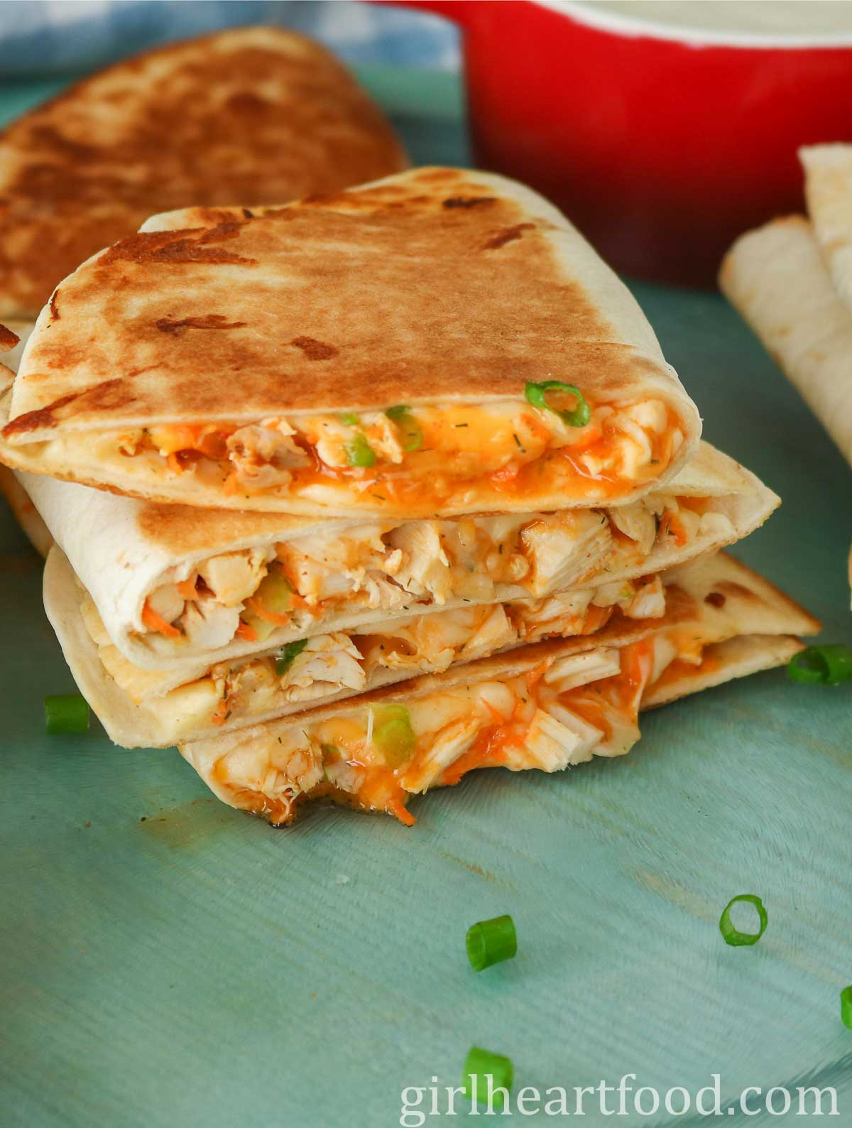 Stack of four buffalo chicken quesadillas.