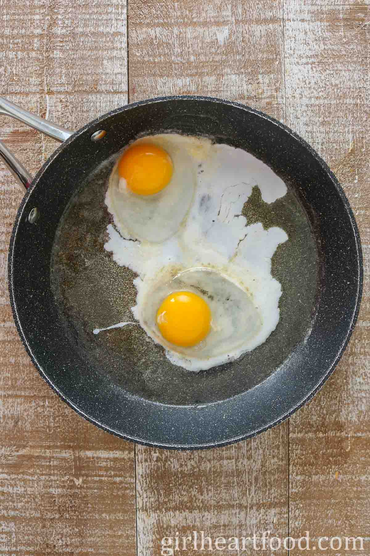 Two eggs in a non-stick pan.