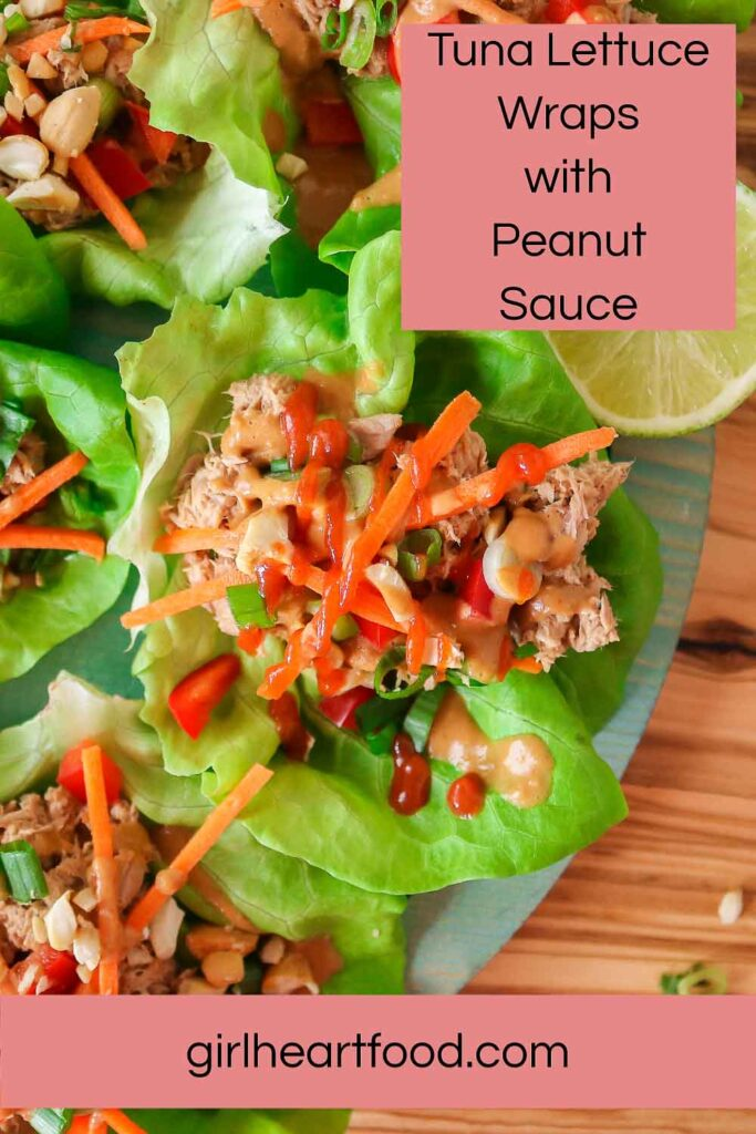 Tuna lettuce wraps with peanut sauce and hot sauce.