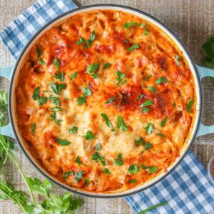 Large round pan of cheesy turkey pasta bake.