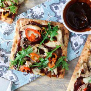 Square slice of BBQ chicken flatbread pizza.