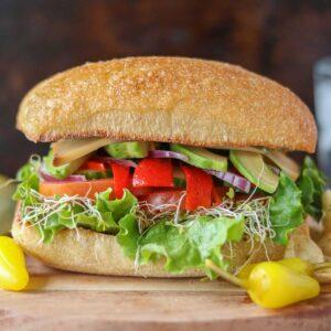 Veggie sandwich on a ciabatta bun.