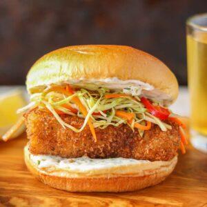Crispy fish burger with tartar sauce and coleslaw.