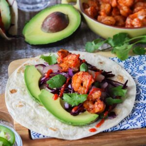 Shrimp taco with toppings.