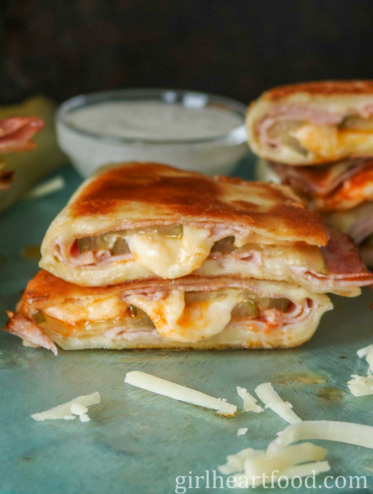 Stack of two pickle, ham and cheese quesadillas.