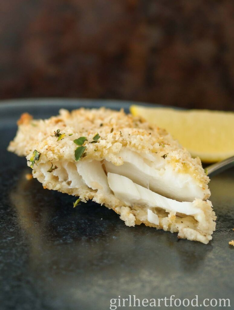 Close-up of a fillet of cooked cod, showing the interior texture.