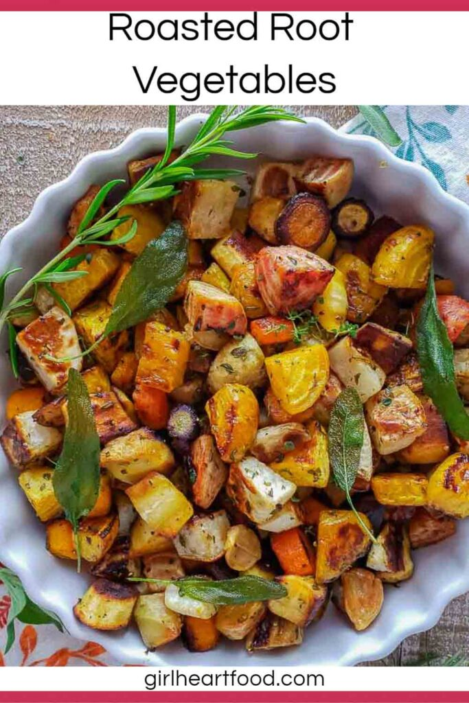 Dish of roasted root vegetables garnished with herbs.