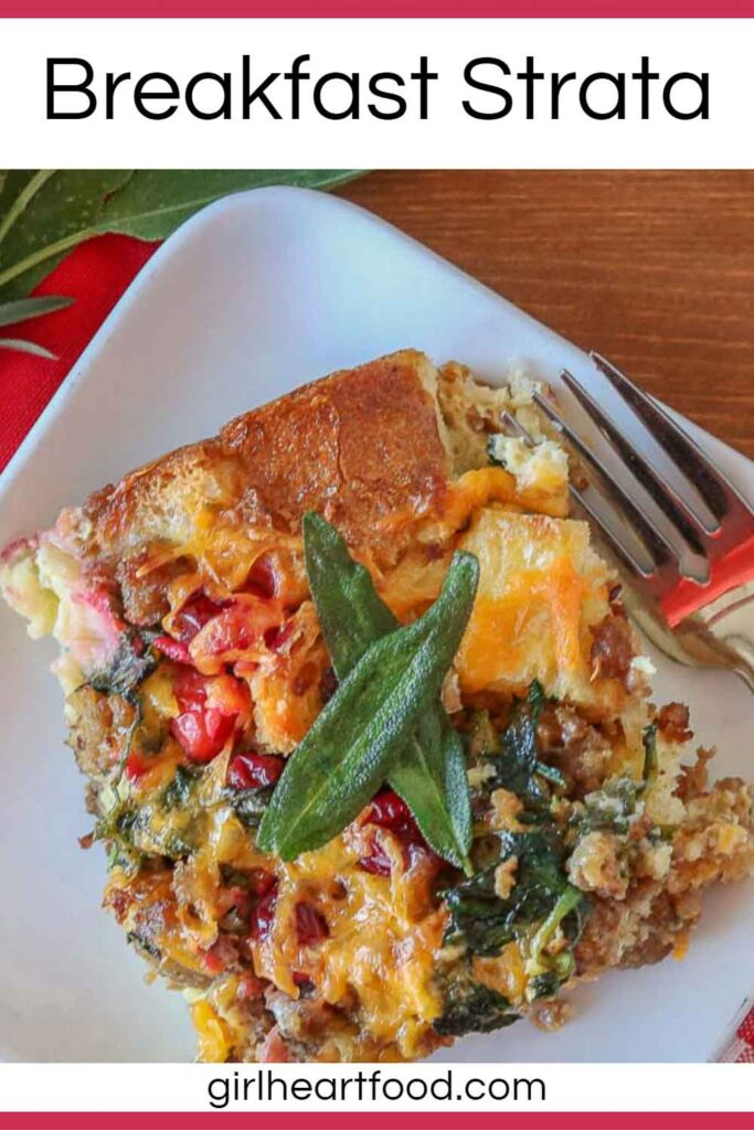 Serving of breakfast strata on a white plate, garnished with crispy sage.