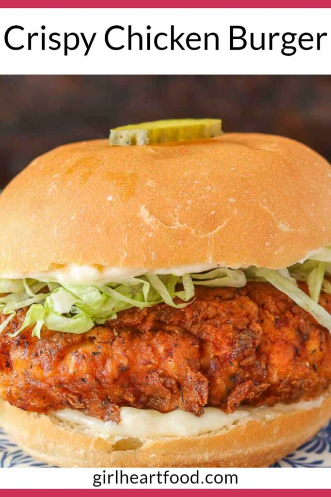 Fried chicken sandwich with a pickle slice on top of the bun.
