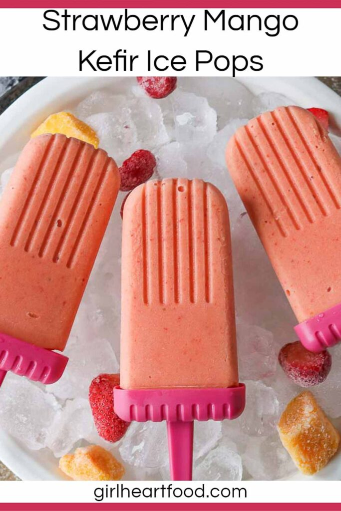 Three strawberry mango ice pops in a dish of ice cubes.