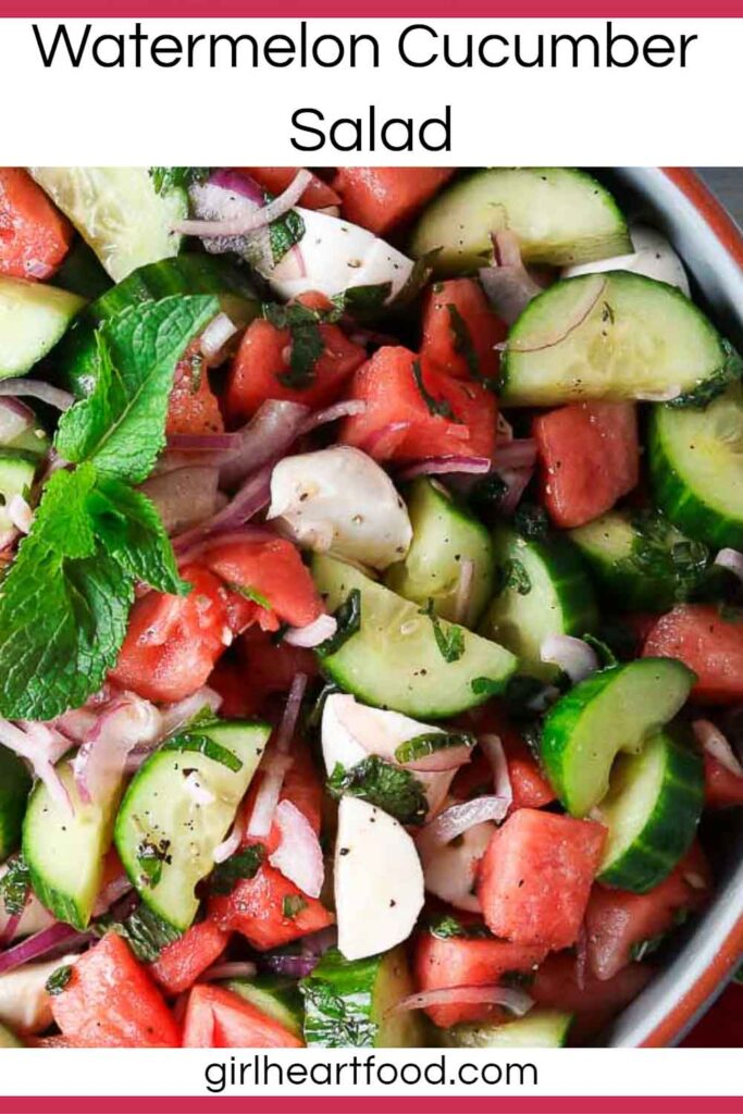 Bowl of watermelon cucumber bocconcini salad with fresh mint.