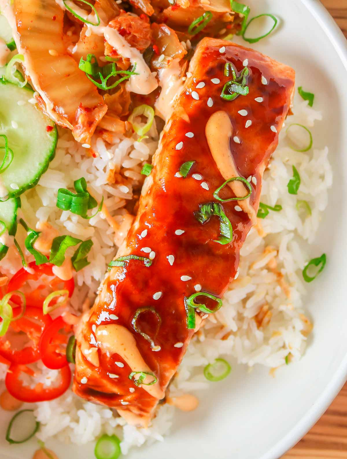 Close-up of a spicy salmon fillet on top of rice.
