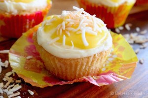 Coconut Cupcakes with Coconut Buttercream and Pineapple Curd - girlheartfood.com